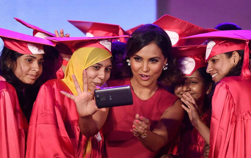 Bollywood actress Lara Dutta taking selfie with the girls who were presented scholarships by the Fair & Lovely Foundation in Mumbai.