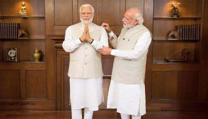 PM Modi meets his 'wax' figure, compares artists with Lord Brahma
