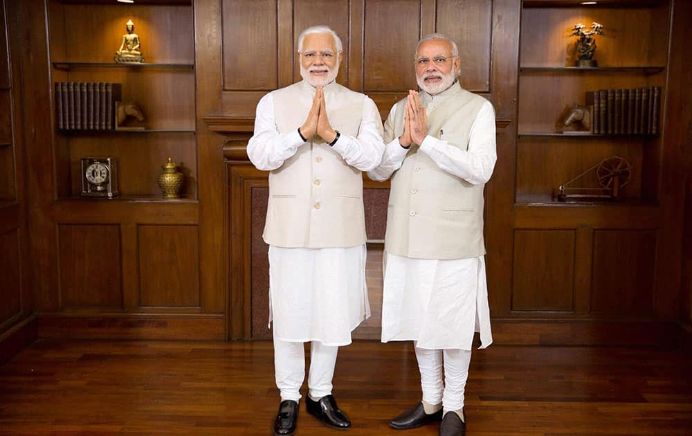 Prime Minster Narendra Modi poses with his wax statue due to be placed at London's Madame Tussauds museum, in New Delhi.