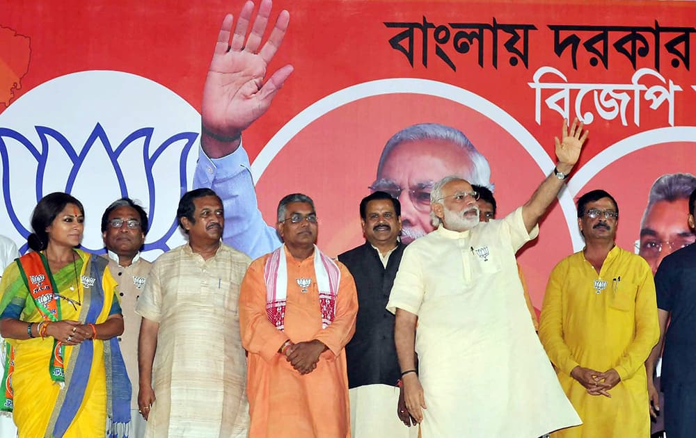 Prime Minister Narendra Modi with actress turned BJP candidate from Howrah-North constituency Rupa Ganguly and others during his election campaign for the West Bengal Assembly polls,in Howrah on Thursday evening.