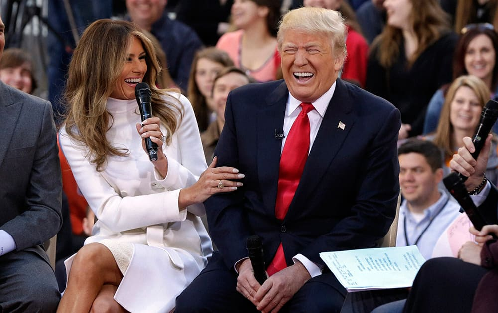 Republican presidential candidate Donald Trump reacts as his wife Melania Trump, answers a question during an interview on the NBC Today television program, in New York.