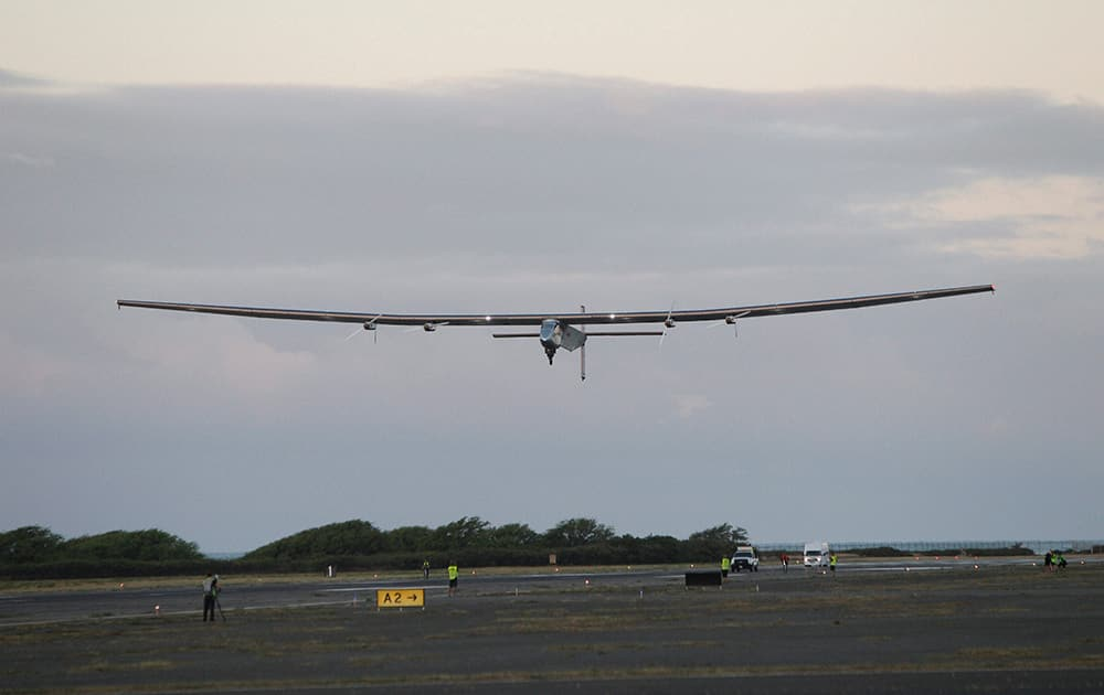 The Solar Impulse 2 solar plane lifts off at the Kalaeloa Airport, in Kapolei, Hawaii.