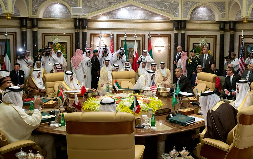 President Barack Obama, seated upper right, speaks with Abu Dhabi's Crown Prince Sheikh Mohamed bin Zayed Al Nahyan during a Gulf Cooperation Council session during the Gulf Cooperation Council Summit in Riyadh, Saudi Arabia.