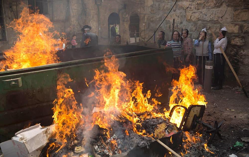 Ultra-Orthodox Jewish men and children burn leavened items in final preparation for the Passover holiday in Jerusalem.