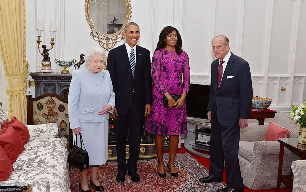 US President Barack Obama and his wife first lady Michelle Obama, pose with Britain's Queen Elizabeth II, left, and Prince Phillip in the Oak room at Windsor Castle ahead of a private lunch hosted by the Queen.