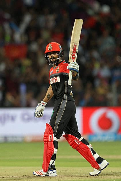 Royal Challengers Bangalore captain Virat Kohli celebrates his fifty against Rising Pune Supergiants during their IPL match at the Maharashtra Cricket Associations International Stadium, Pune.