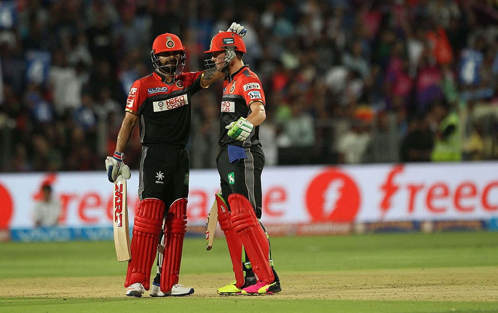 Royal Challengers Bangalore captain Virat Kohli congratulates AB de Villiers of Royal Challengers Bangalore on his fifty against Rising Pune Supergiants during their IPL match at the Maharashtra Cricket Associations International Stadium, Pune.