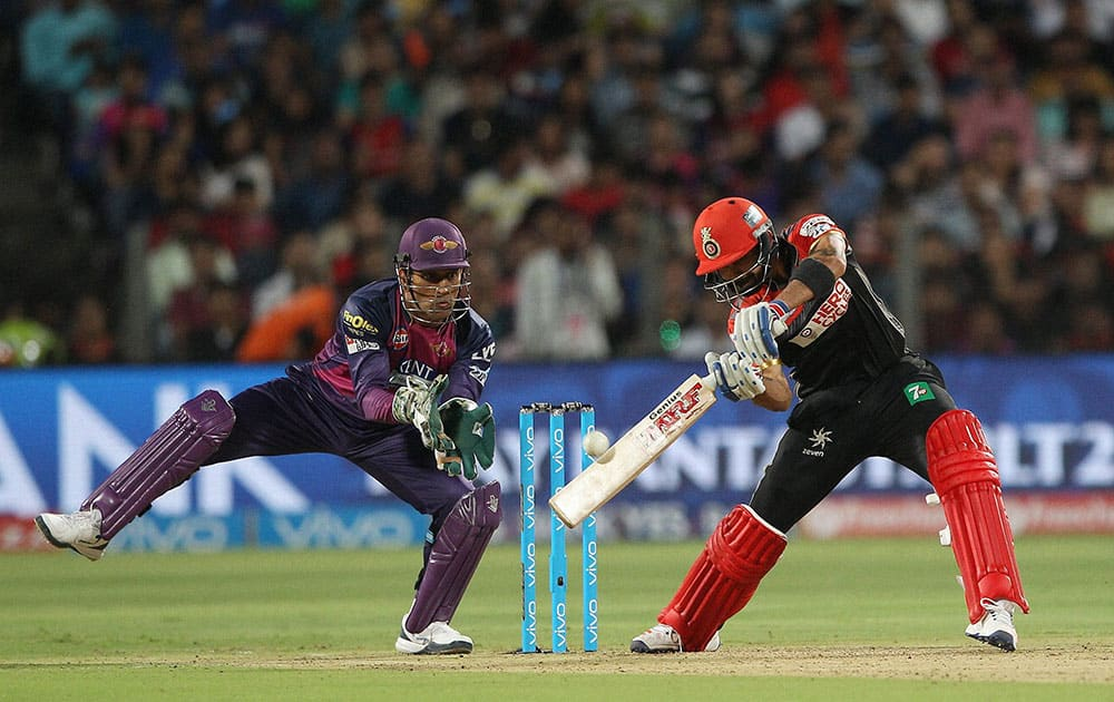 Royal Challengers Bangalore captain Virat Kohli plays a shot against Rising Pune Supergiants during their IPL match at the Maharashtra Cricket Associations International Stadium.
