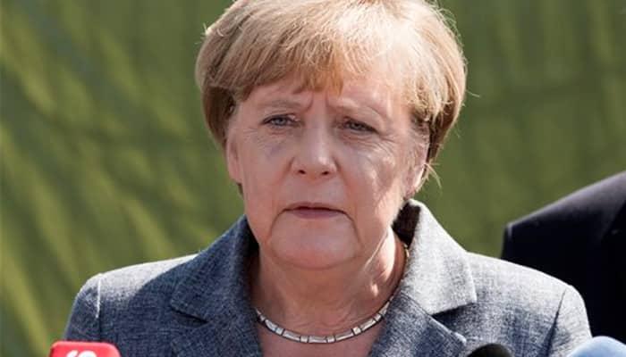 Tensions over migrant deal as Angela Merkel, EU officials head to Turkey