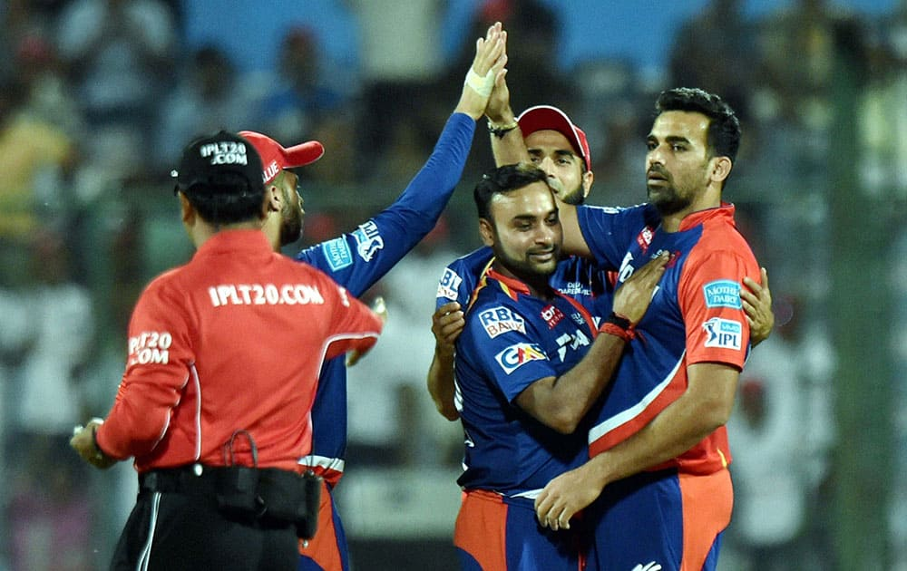 Delhi Daredevils Zaheer Khan celebrates a wicket with team mates during their IPL T20 match against Mumbai Indians in New Delhi.