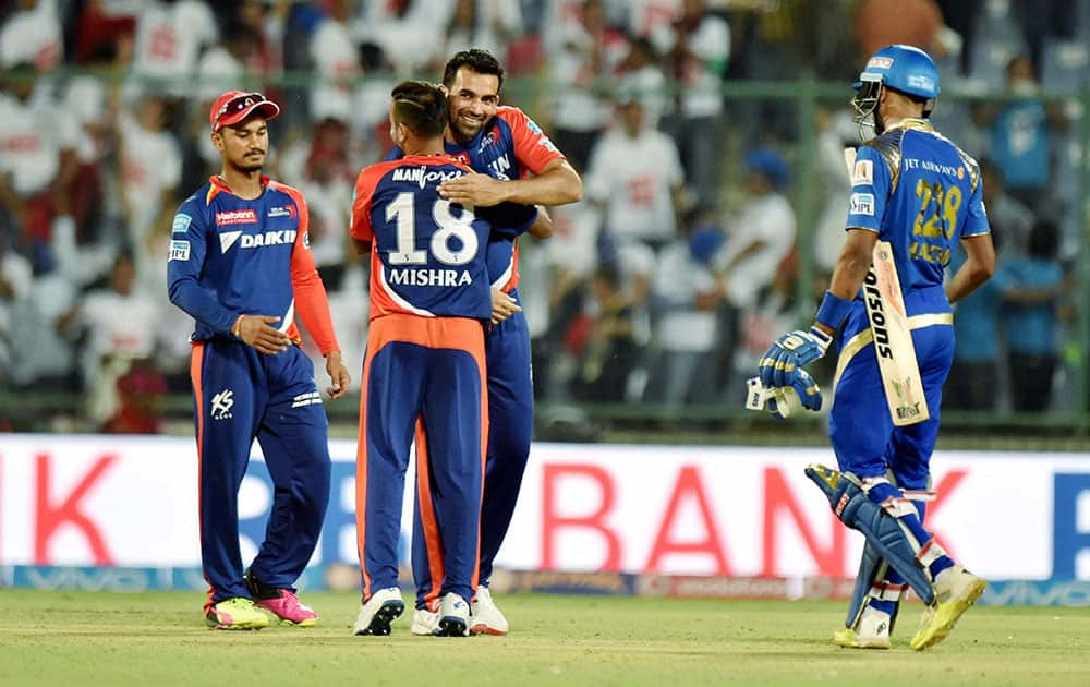 Delhi Daredevils Zaheer Khan celebrates with a team mate after their win over Mumbai Indians in the IPL T20 match in New Delhi.