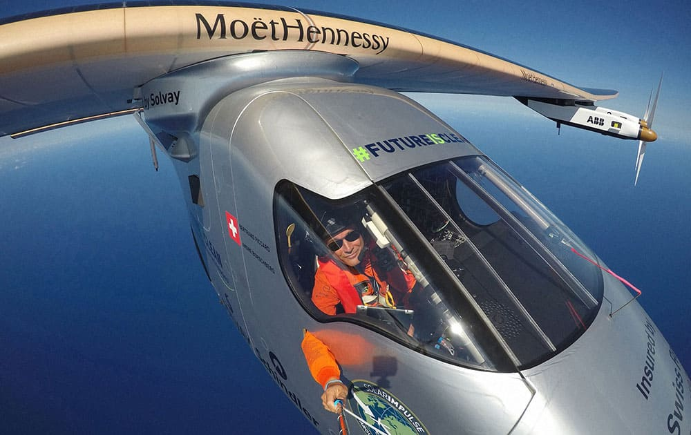 Piccard taking a selfie on board Solar Impulse 2 during a test flight over the Pacific Ocean. The solar-powered airplane on an around-the-world journey had traveled 80 percent of the way from Hawaii to California by Saturday, April 23.