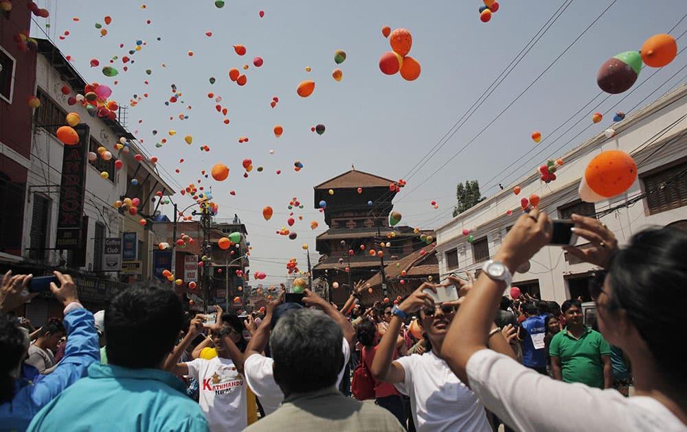 Nepalese people release balloons in memory of those who died in last year's devastating earthquake in Kathmandu, Nepal.
