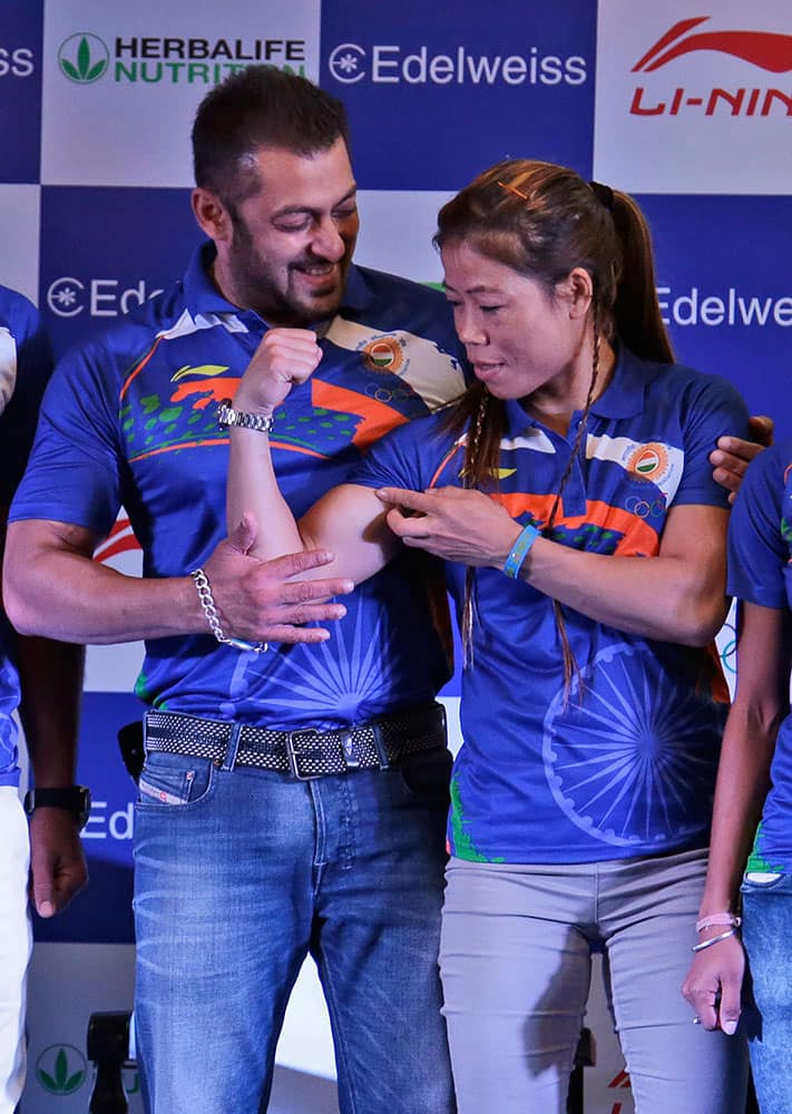 Indian boxer Mary Kom, right, playfully flexes her biceps to tease Bollywood actor Salman Khan, left, at an event to announce Khan as the goodwill ambassador for Rio Olympics 2016 in New Delhi, India.