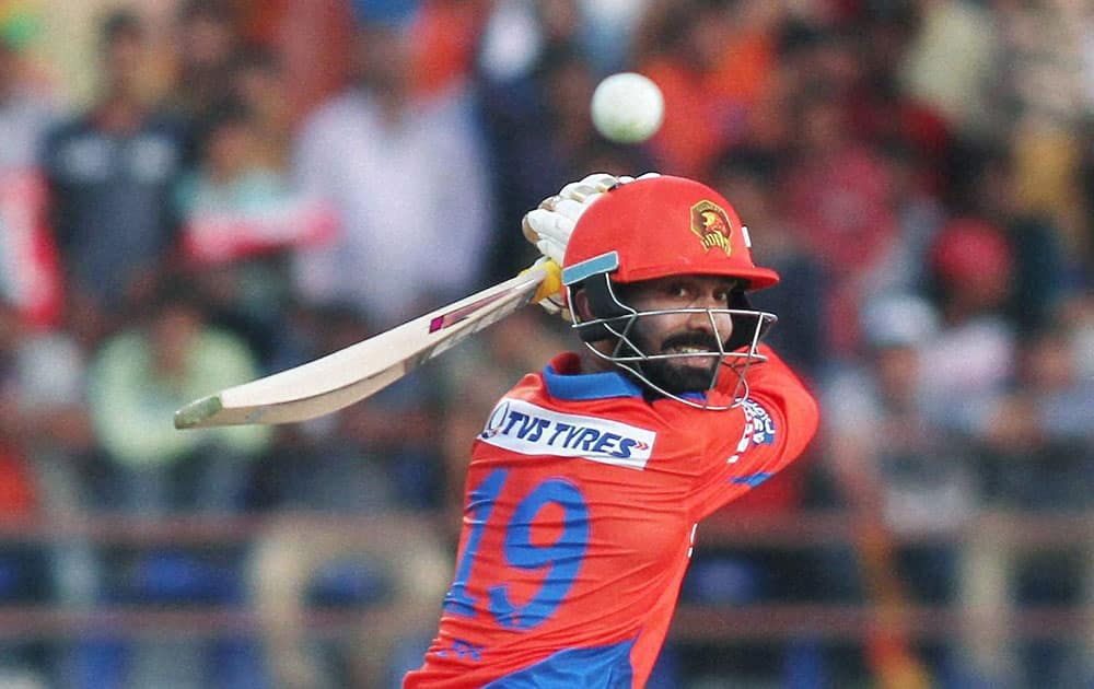 Gujarat Lions Player Dinesh Karthik plays a shot during IPL 2016 match against Royal Challengers Bangalore in Rajkot.