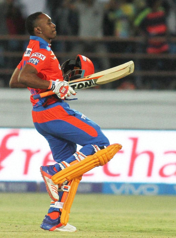 Gujarat Lions Player Dwayne Bravo celebrate after winning match against Royal Challengers Bangalore in Rajkot.