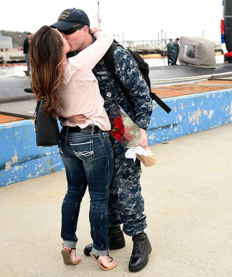 Seaman Jordan Orr is greeted by his wife Kristie Orr as the U.S. Navy submarine USS Toledo (SSN 769) returns to the Navy Submarine Base in Groton, Conn.