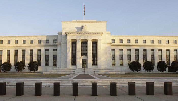 Fed keeps key rate unchanged, noting slower US growth