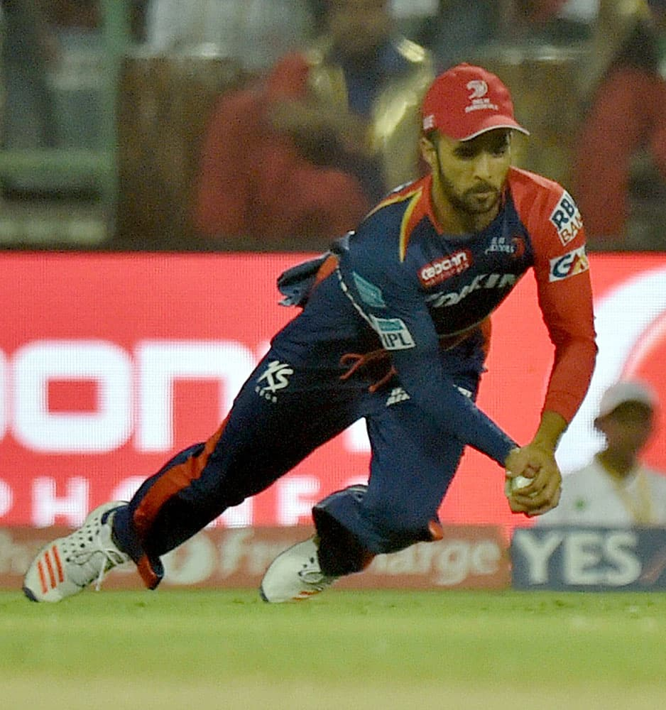 Delhi Daredevils player Duminy takes catch of Gujarat Lions batsman Dinesh Karthik during an IPL T20 match at Ferozshah Kotla in New Delhi.