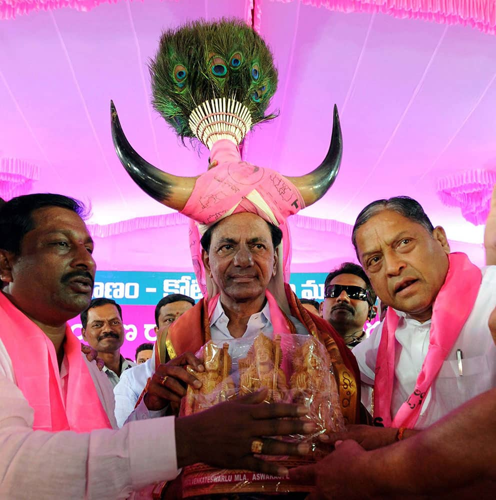 TRS President and Chief Minister of Telangana K Chandra Sekhar Rao being honored by party workers at a public meeting at Khammam district of Telangana.