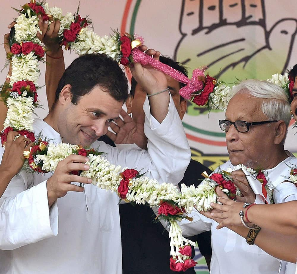 Congress Vice President Rahul Gandhi and former West Bengal Chief Minister and CPI(M) leader Buddhadeb Bhattacharjee being garlanded at a joint election campaign rally in Kolkata.