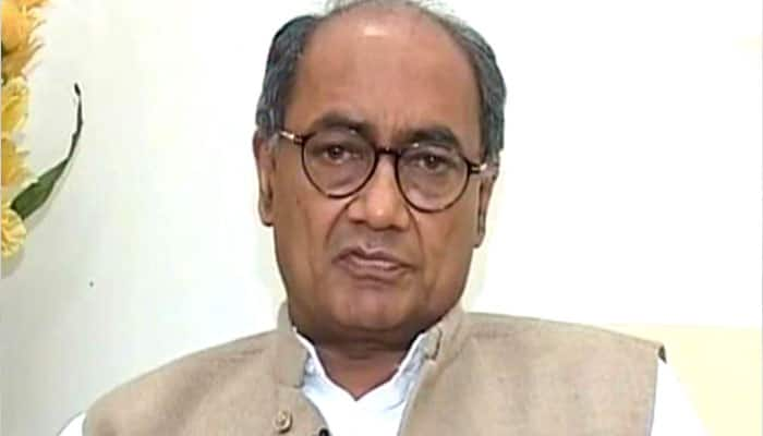 RSS critic Digvijay Singh visits VHP office in Delhi, gifted Ashok Singhal's biography
