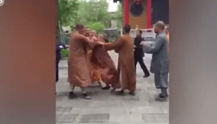 It's actually shocking! Three monks get involved in brawl at Buddhist temple in China - Watch