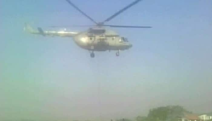 Uttarakhand forest fire: IAF's chopper MI-17 takes off from Nainital to drop water in affected areas - WATCH