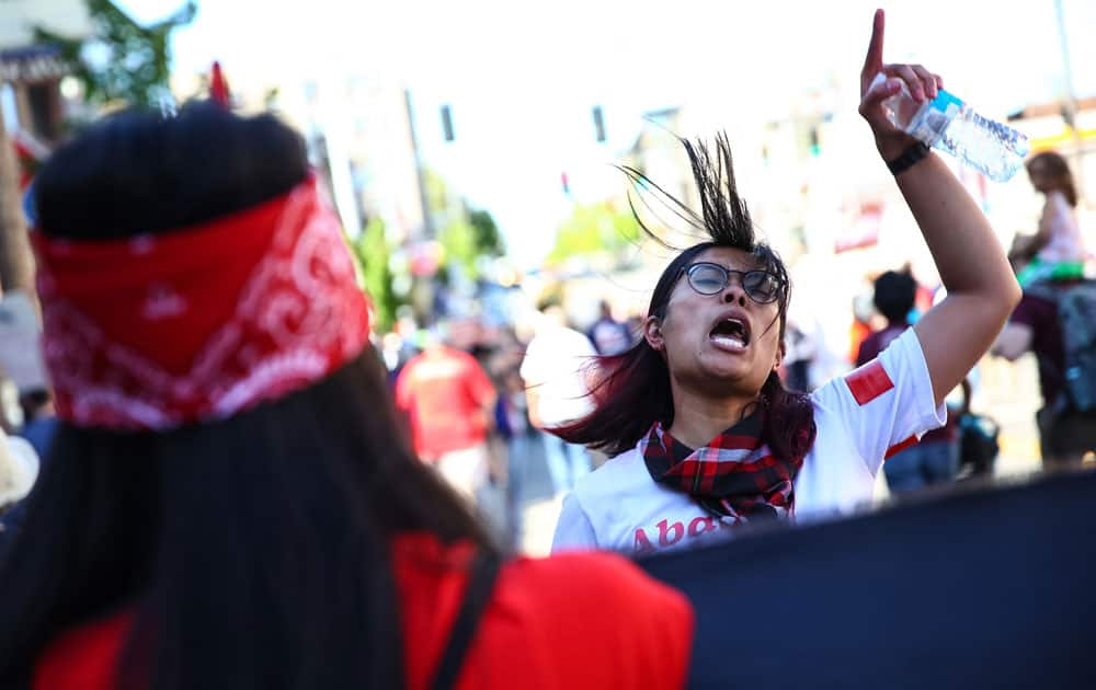 People participate in a march for immigrant and worker rights in Seattle.