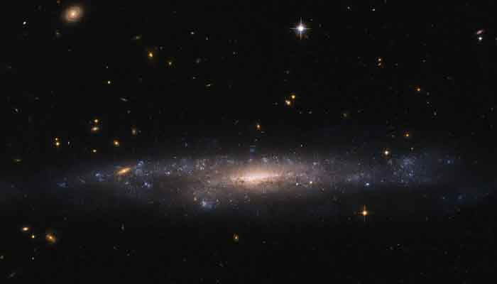 Hubble spots galaxy hidding in night sky – See pic!
