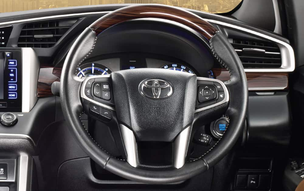 Leather wrapped Steering Wheel with wood finish.