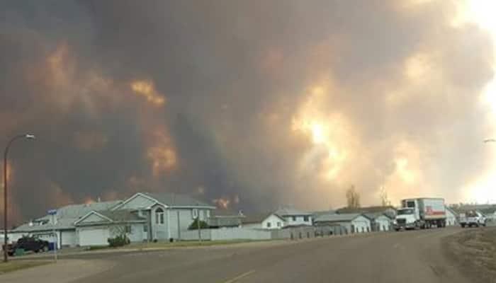 Canadian city evacuated as huge blaze engulfs homes