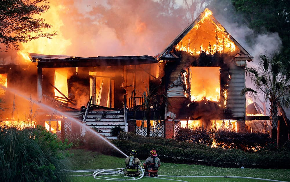 St. Tammany firefighters battle a house fire in Flowers Estates North Subdivision between Covington and Madisonville.