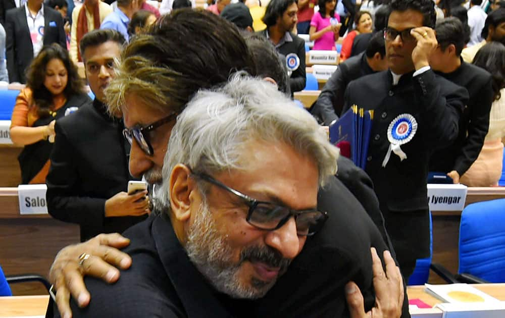 Winner of Best Actor award Amitabh Bachchan and winner of Best Director award Sanjay Leela Bhansali greet each other at the 63rd National Film Awards 2015 function in New Delhi.