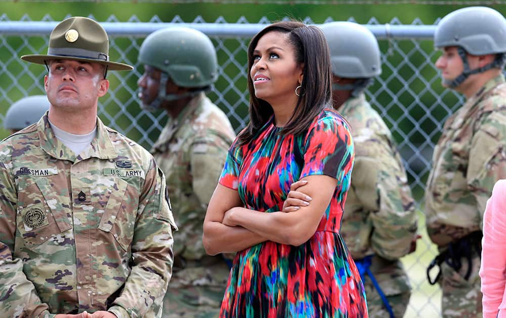 First lady Michelle Obama looks up at the Warrior Tower where soldiers learn to rappel while visiting Fort Leonard Wood, Mo.