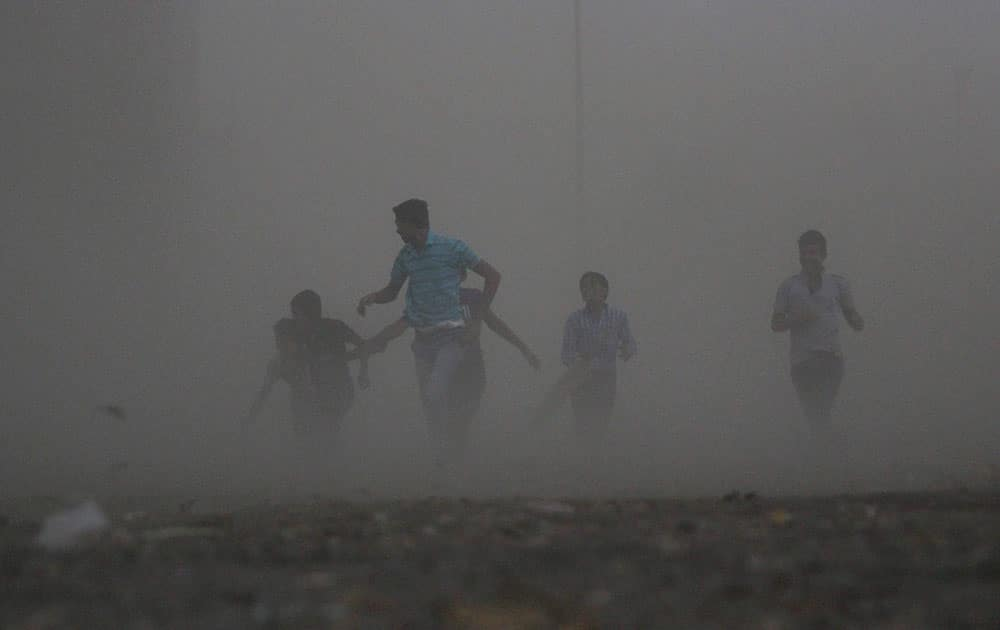 Children caught in strong wind on the outskirts of Nagpur.