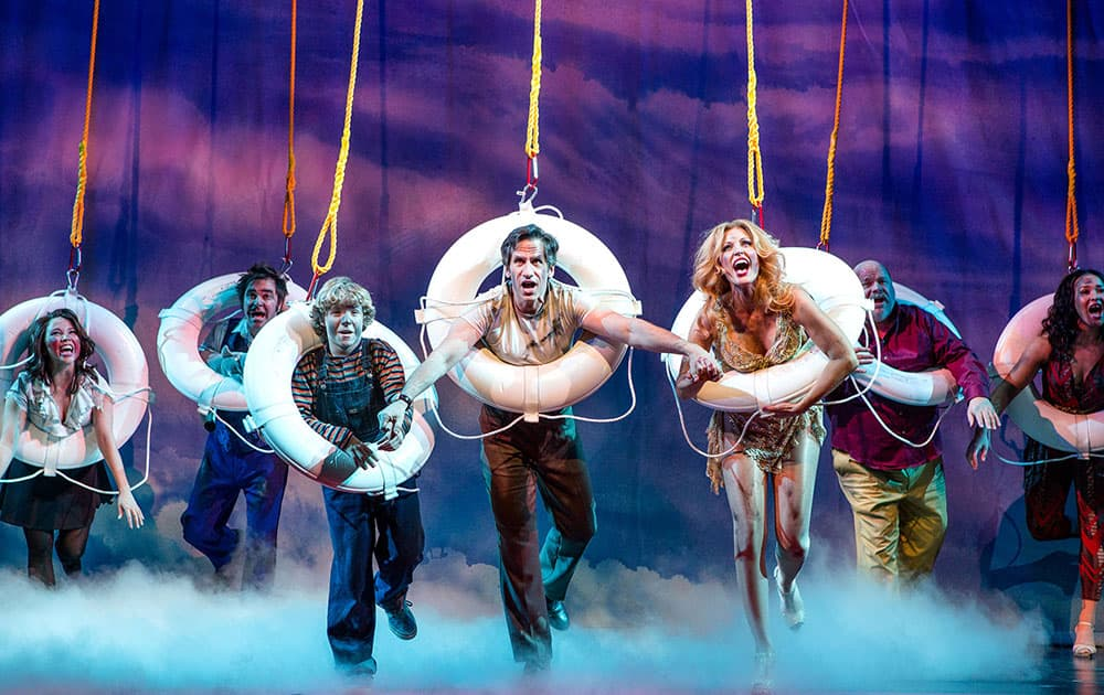 This image released by Polk and Co., shows cast members, from left, Catherine Ricafort, Roger Bart, Baylee Littrell, Seth Rudetsky, Rachel York, Kevin Chamberlain and Olivia Phillip during a performance of, 'Disaster!.' Rudetsky is one of many actor-playwrights currently performing on the New York stage.