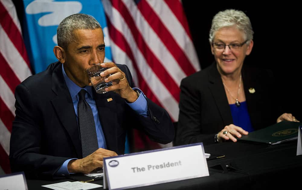 President Barack Obama drinks filtered Flint tap water at a roundtable discussion with city, state and national officials, at the Food Bank of Eastern Michigan in Flint.