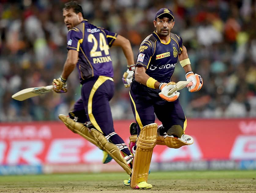 KKR batsmen Robin Uthappa and Yusuf Pathan cross each other to complete singles during IPL match against Kings XI Punjab at Eden Garden in Kolkata.