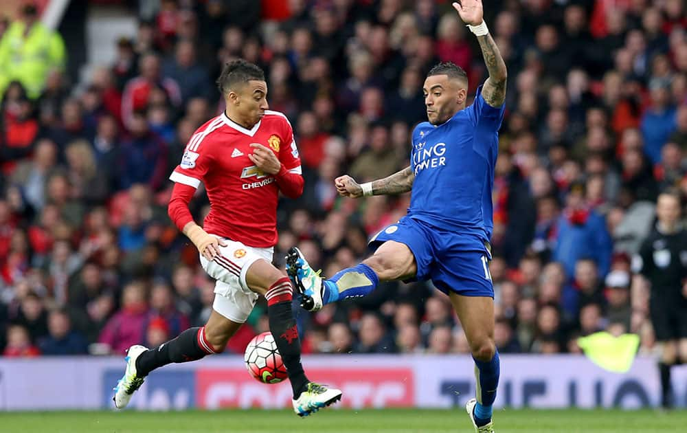 Manchester United's Jesse Lingard, left, and Leicester City's Danny Simpson in action during their English Premier League soccer match at Old Trafford.
