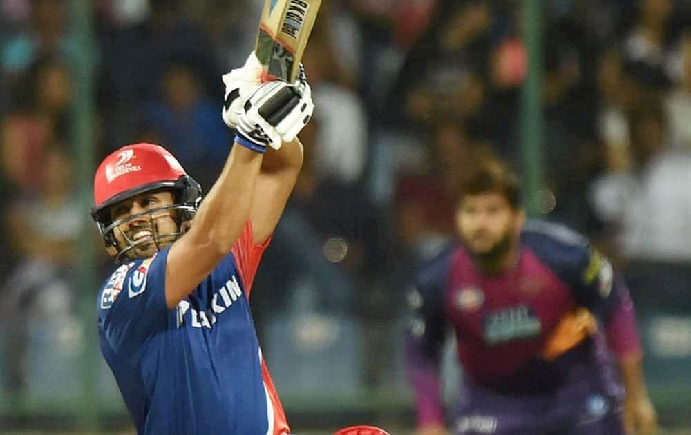 Delhi Daredevils player K K Nair plays a shot during IPL match against Rising Pune Supergiants at Ferozshah Kotla in New Delhi.