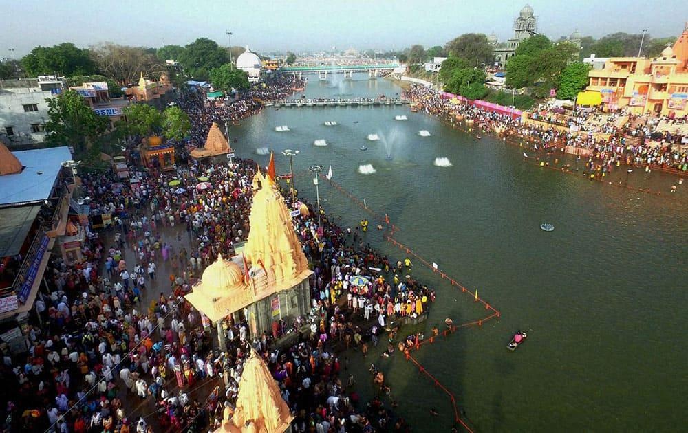 Devotees take holy dip in River Kshipra during Simhastha Maha Kumbh Mela in Ujjain.