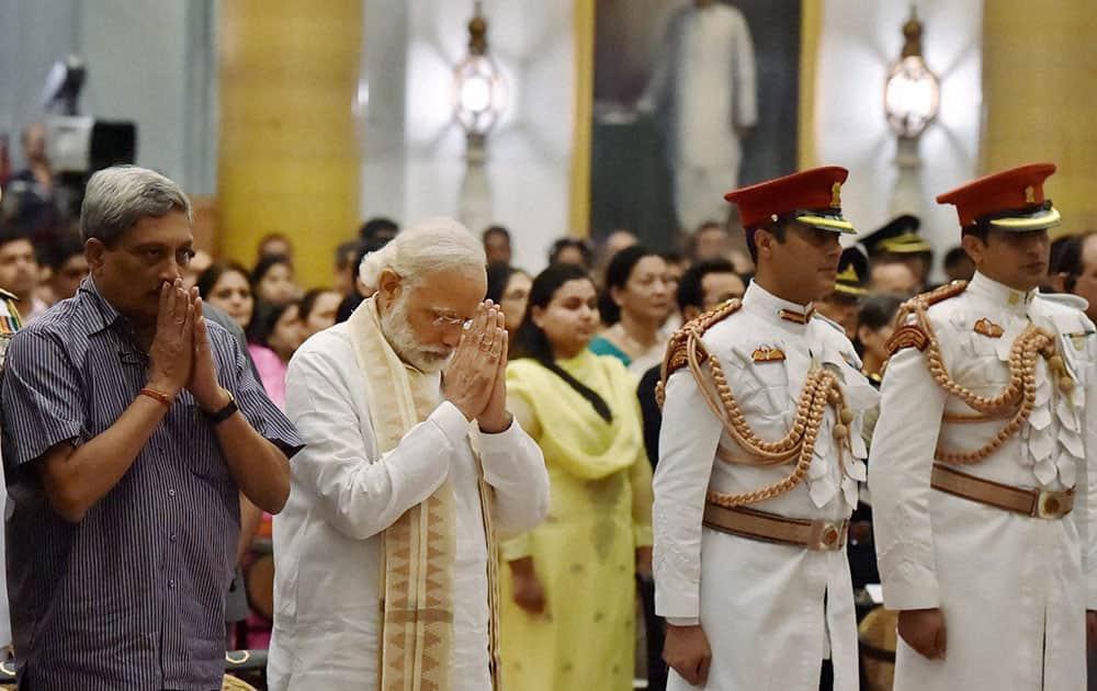 Prime Minister Narendra Modi and Defence Minister Manohar Parrikar greet President Pranab Mukherjee during the Defence Investiture Ceremony at Rashtrapati Bhawan in New Delhi.