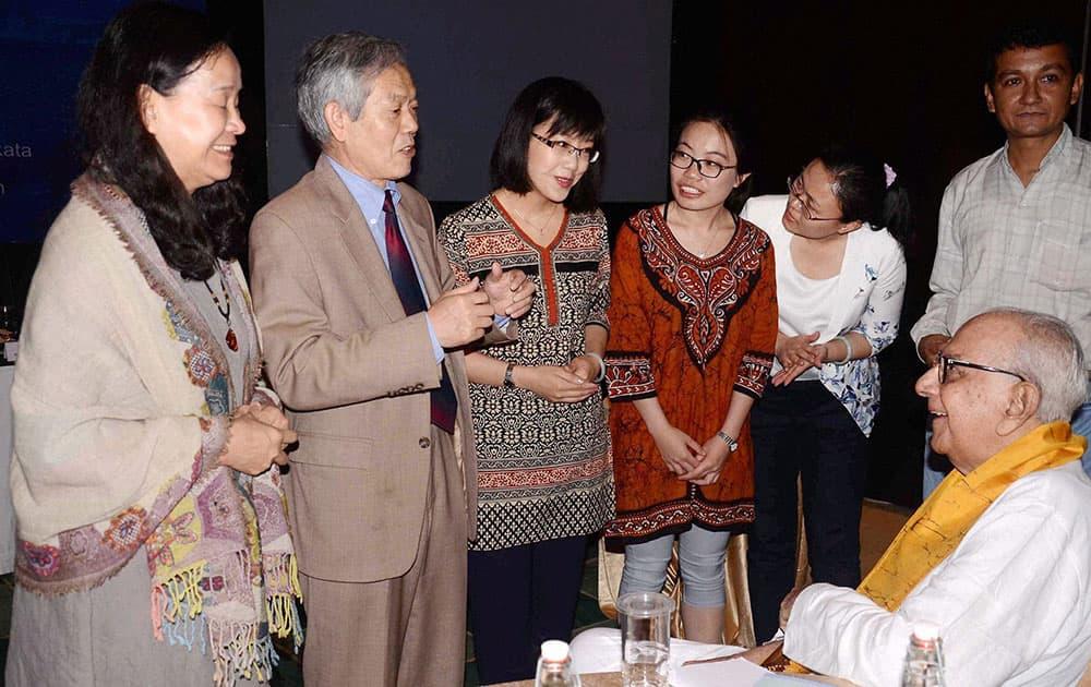 Nobel laureate Rabindranath Tagores grand nephew Amitendranath Tagore interacts with a Chinese delegation at a seminar on Tagore & China, on the eve of Tagores 155th birth anniversary, in Kolkata.
