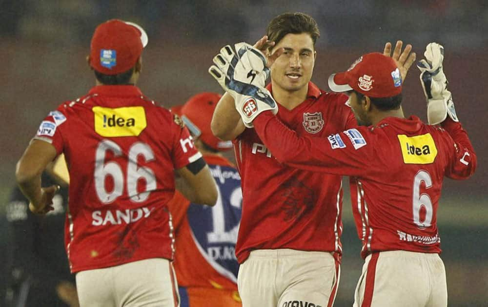 Marcus Stoinis of Kings XI Punjab celebrates the wicket of Quinton de Kock of Delhi Daredevils during am IPL 2016 match in Mohali.