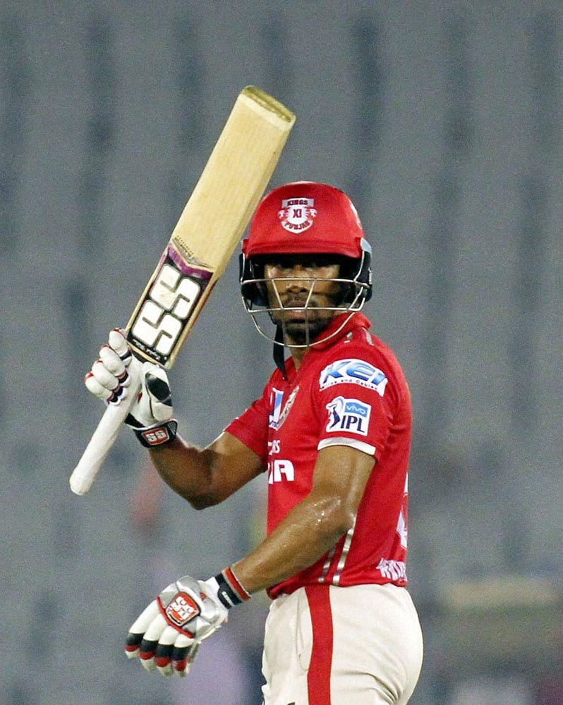 Kings XI Punjabs Wriddhiman Saha celebrates his half century during IPL match between the Kings XI Punjab and the Delhi Daredevils in Mohali.