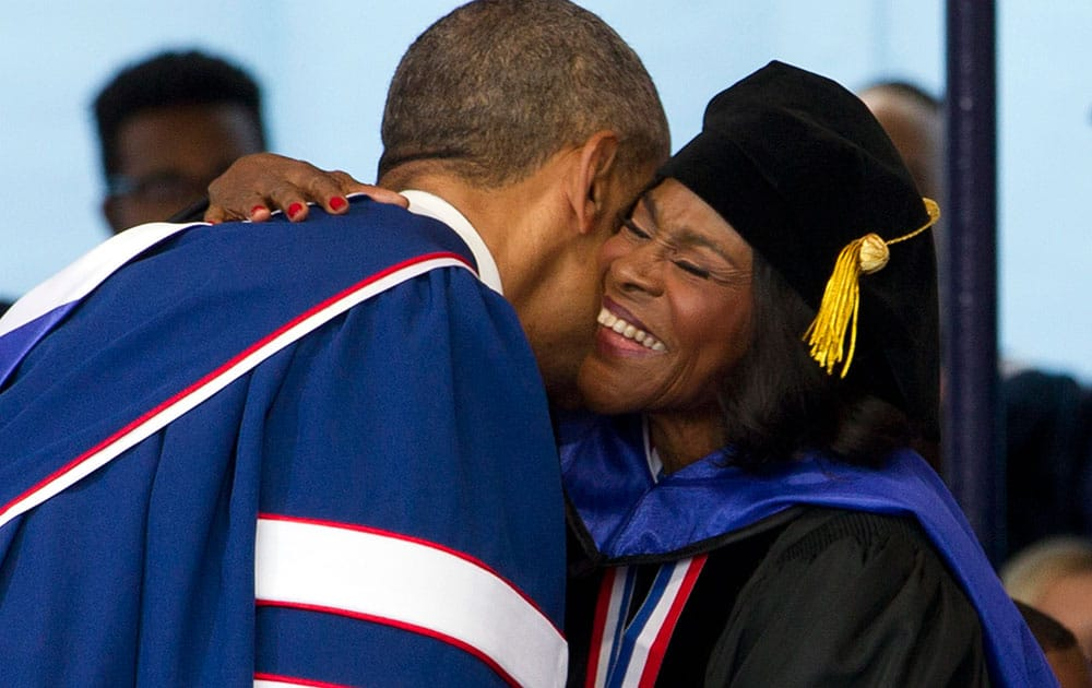 President Barack Obama hugs Actress Cicely Tyson after she received an honorary degree, during the 2016 Howard University graduation ceremony in Washington.