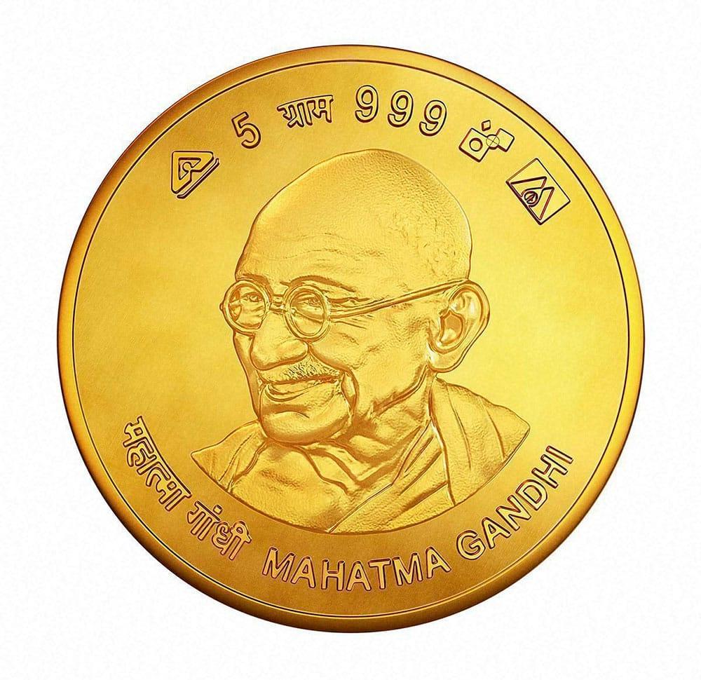 Government lanching gold coins bearing Mahatma Gandhis image,on the occasion of Akshaya Tritiya.