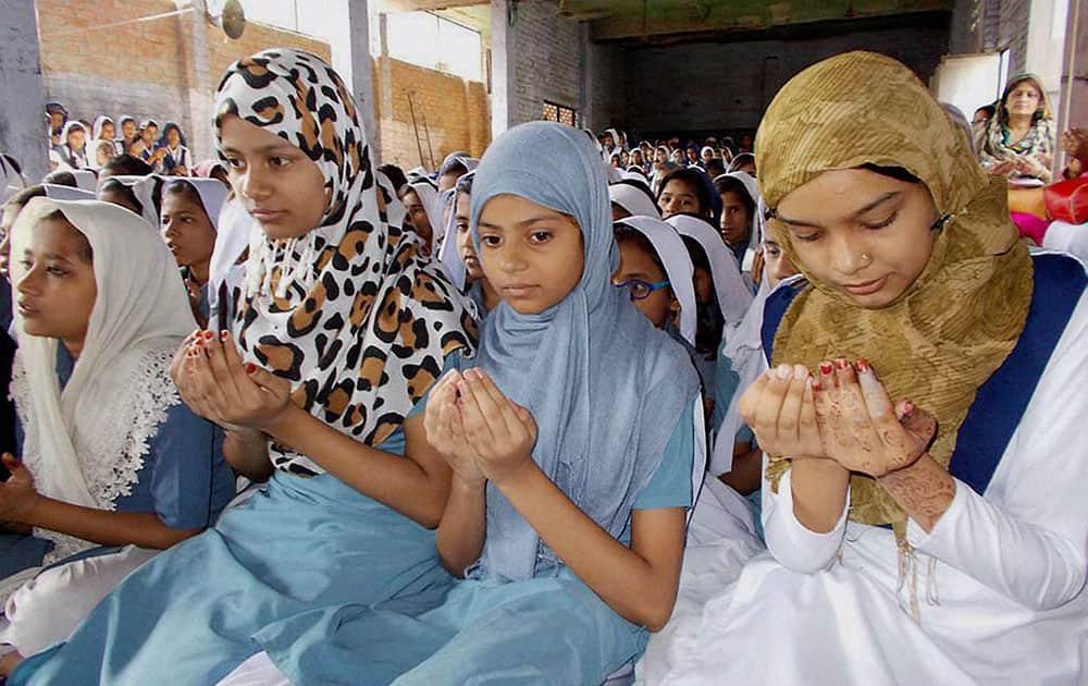 Muslim girls praying on the eve of Mothers Day at a Muslim college in Varanasi, Uttar Pradesh.