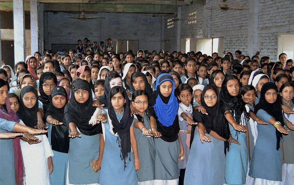 Muslim girls taking oath on the eve of Mothers Day at a Muslim college in Varanasi, Uttar Pradesh.